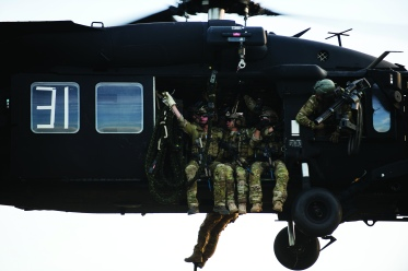 U.S. Army Soldiers from the 7th Special Forces Group prepare to fast-rope out of a UH-60 Blackhawk during Fast Rope Insertion and Extraction training as part of Emerald Warrior at Hurlburt Field, Fla., April 22, 2015. Emerald Warrior is the Department of Defense's only irregular warfare exercise, allowing joint and combined partners to train together and prepare for real world contingency operations. (U.S. Air Force photo by Staff Sgt. Kenneth W. Norman/Released)